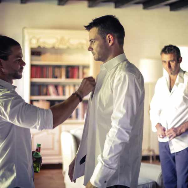 Dressing the Groom. Whilst getting ready for a French wedding.