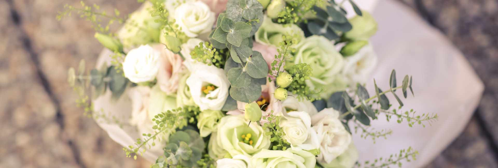 Wedding flowers, with a vintage feel and pale colours.