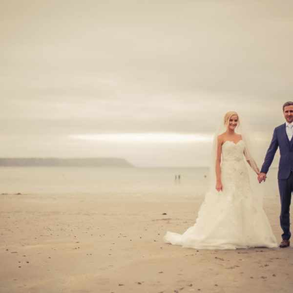 Wedding on the beach with bride and groom in Cornwall.