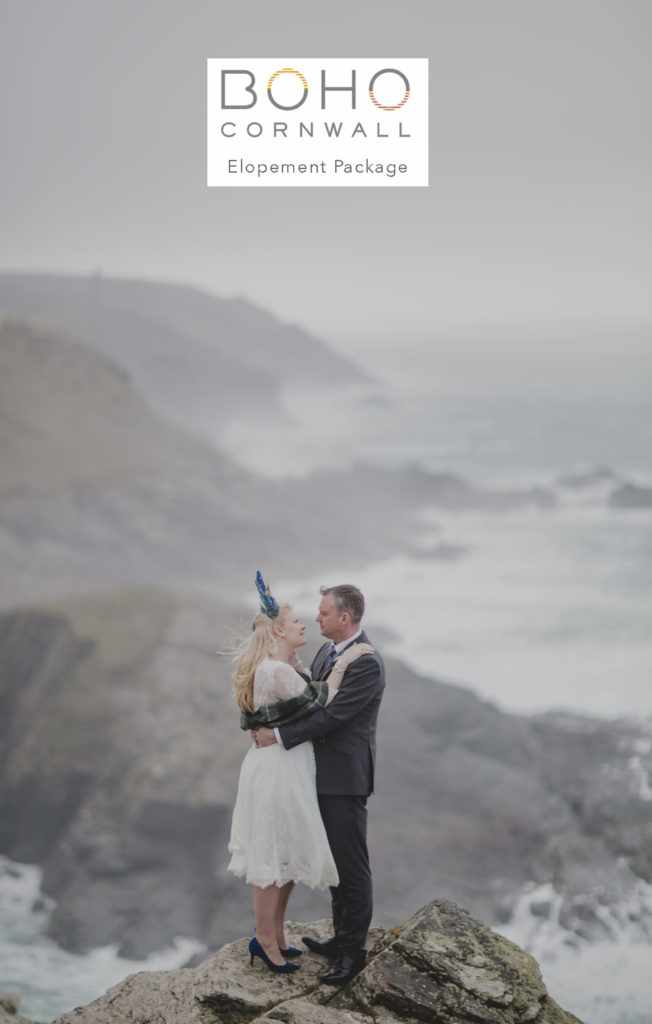 Cornwall Elopement wedding with a bride and groom standing in a cliff.