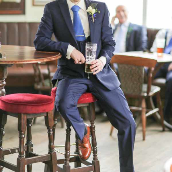 Wedding photographer captures natural and relaxed pose by this groom.