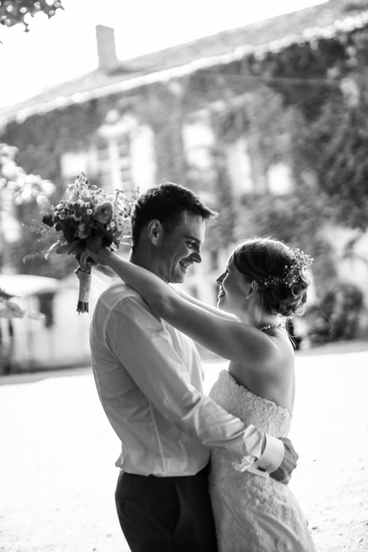 A bride and groom holding to each other. A french wedding shot in artistic black and white.