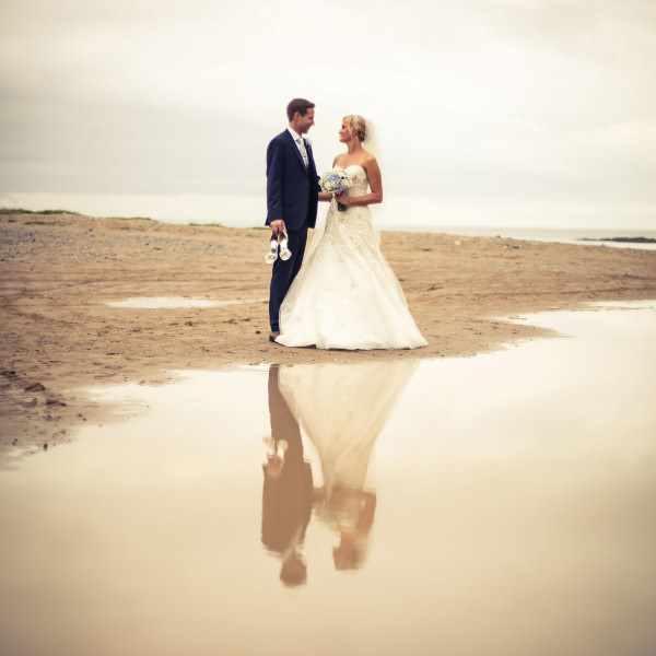 Couple on a beach during their wedding.