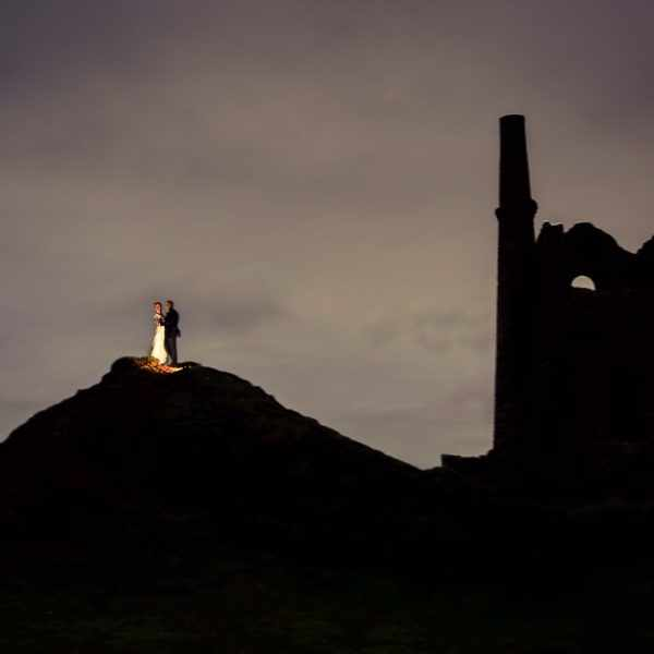 elope, wedding photographers. The best wedding photography photo of a couple holding one another next to a Cornish tin mine.