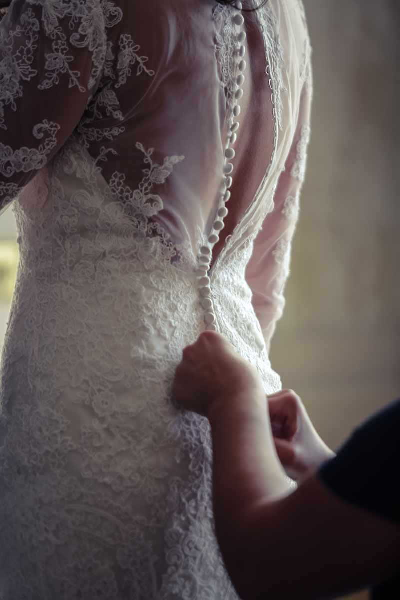 Wedding Dress being laced up. Devon wedding photography