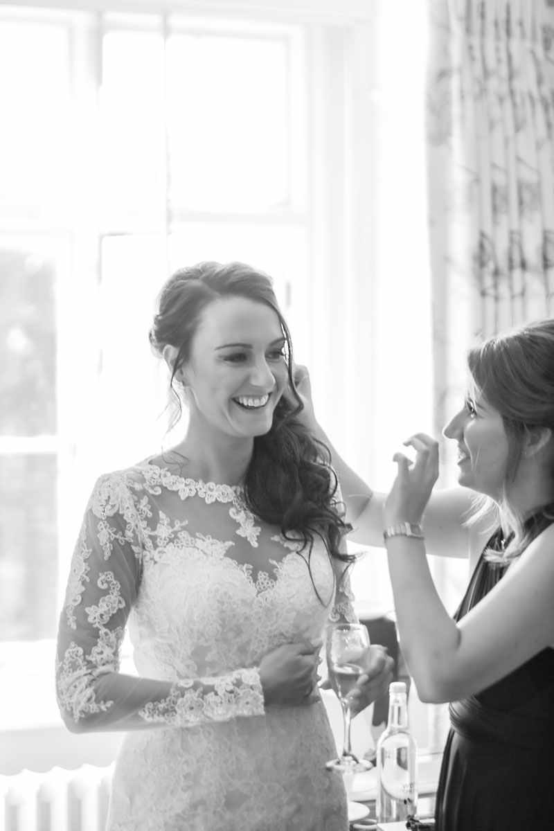 Bride of a wedding having her hair finished. Wedding photograph ,Devon wedding photography