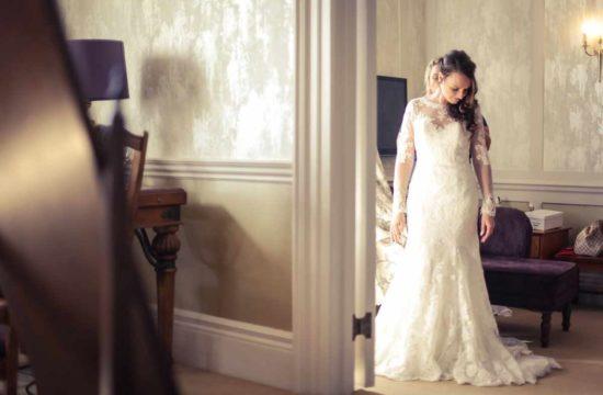 A Bride getting ready for her wedding. In her wedding dress in a room in a wedding venue in Devon