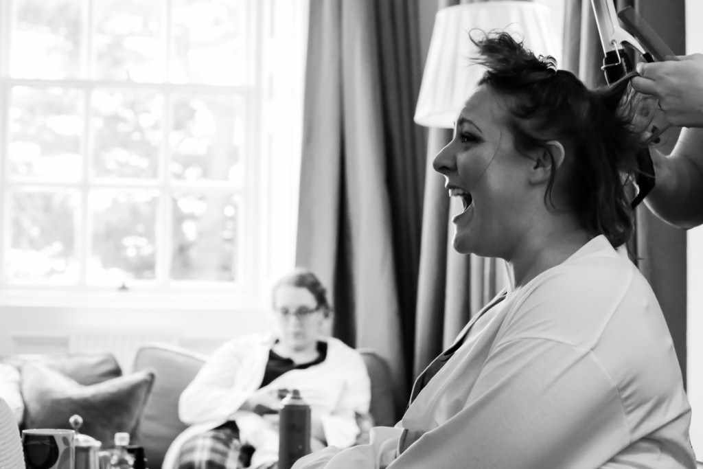 A laughing bride wedding by a Cornwall wedding photographer