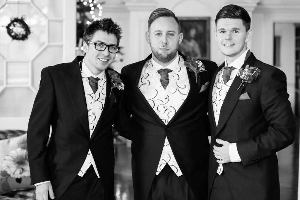 The groom and the groomsmen at a wedding by a Cornwall wedding photographer