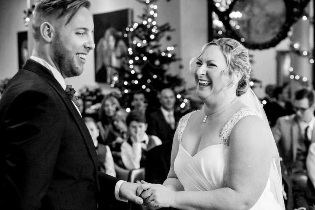 Laughing bride and groom at a wedding by a Cornwall wedding photographer