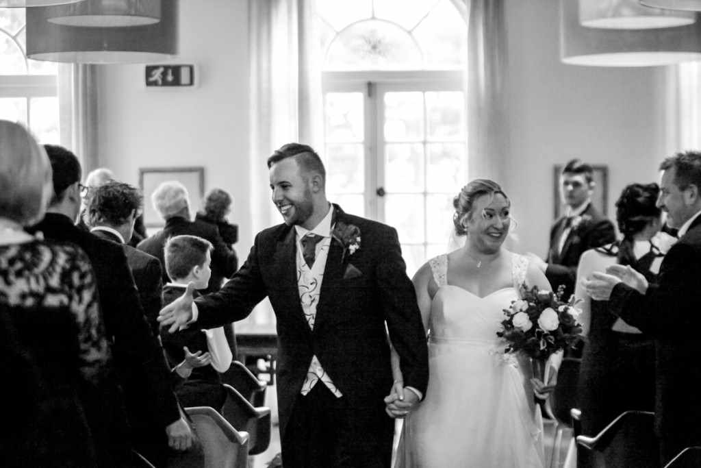 Bride and groom walking down the isle of a Cornish wedding