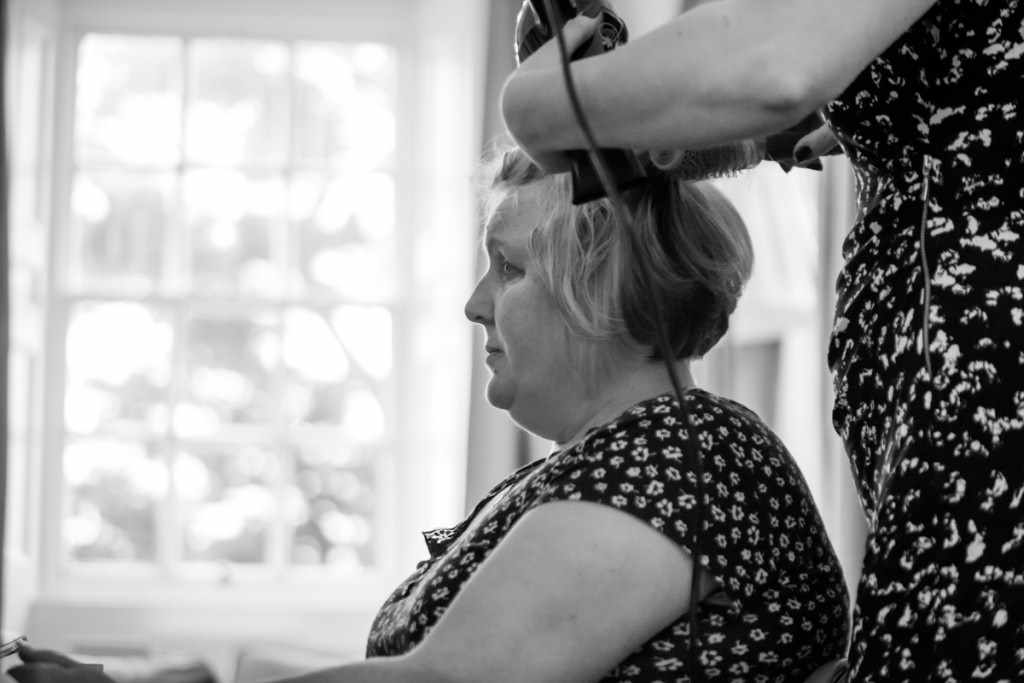 Hair being made at a wedding by a Cornwall wedding photographer