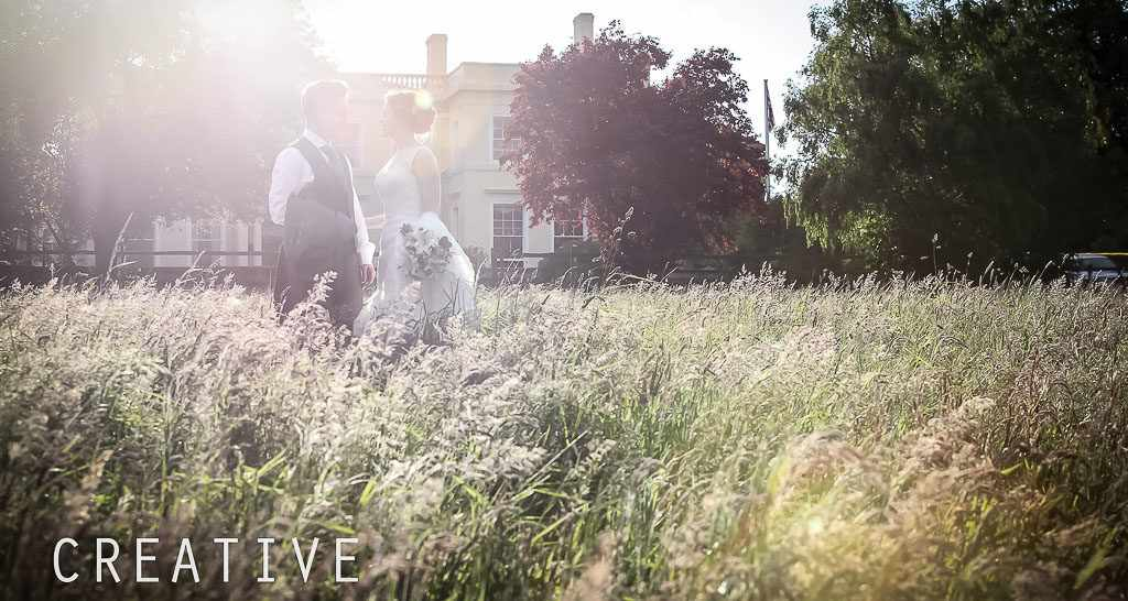 Cornwall Wedding Photographer in long grass with a bride and groom