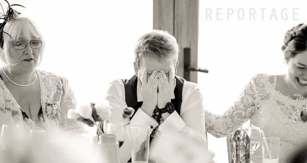 Groom with hands on his head a documentary wedding photography as a Cornwall wedding photographer