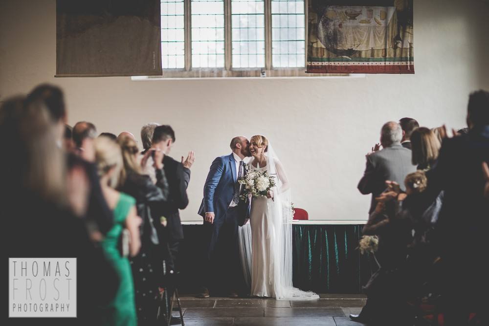 Groom kissing the bride at Prittlewell Priory Wedding, Southend-on-sea.