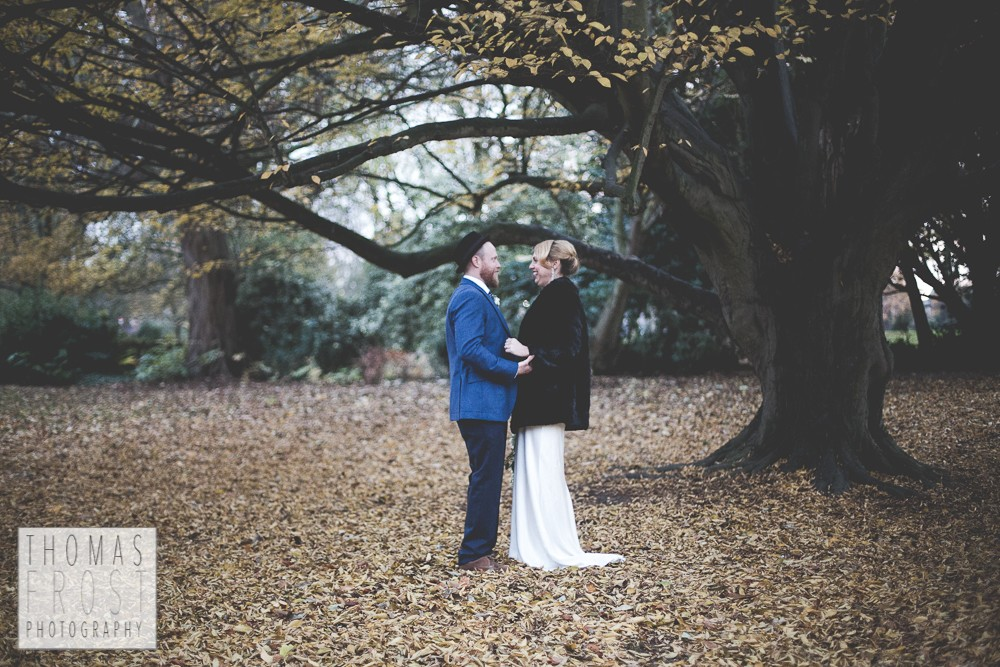 Bride and Groom under a tree at Prittlewell Priory Wedding, Southend-on-sea.