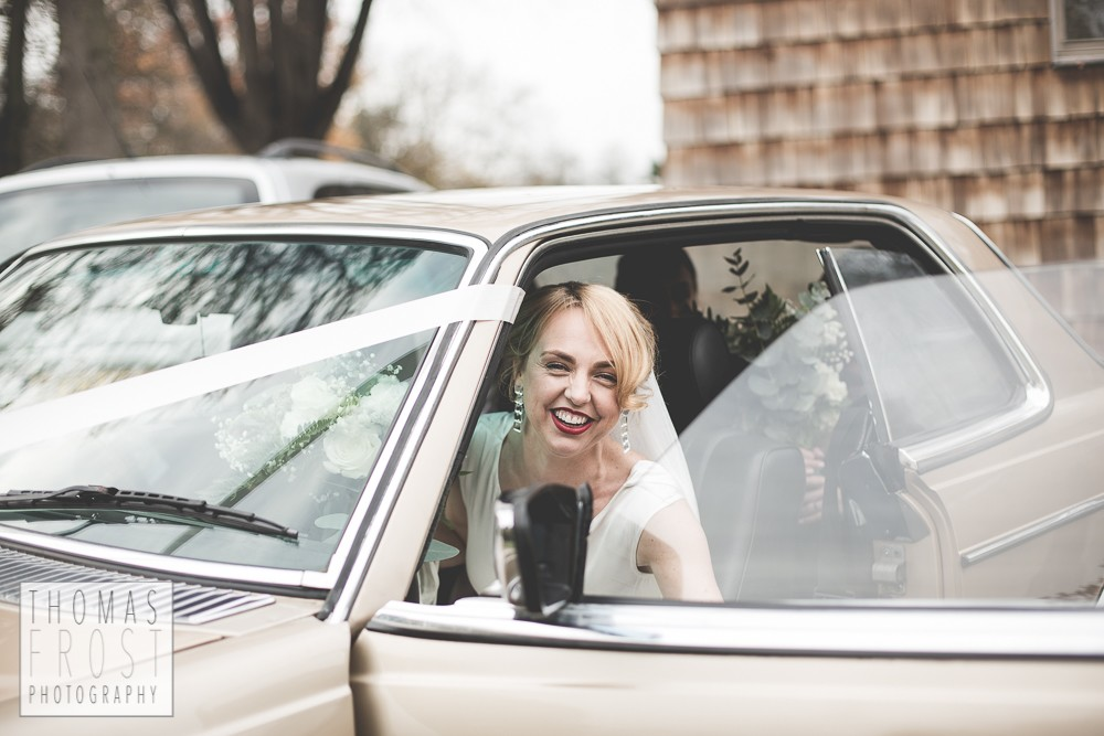 Bride getting out of wedding car at Prittlewell Priory Wedding, Southend-on-sea.