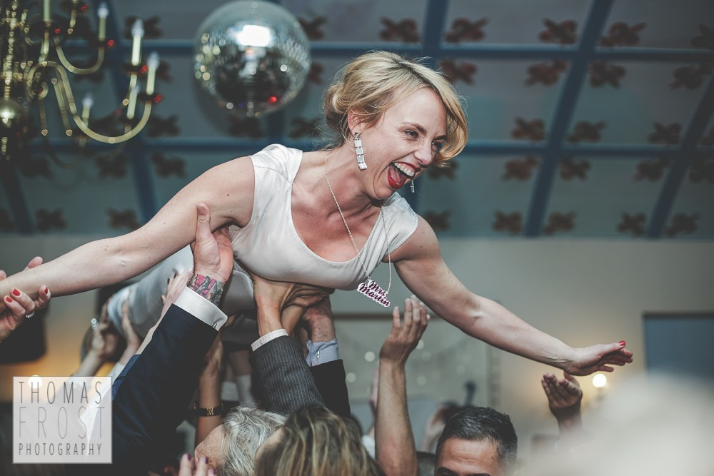 Crowdsurfing bride at Prittlewell Priory Wedding, Southend-on-sea.