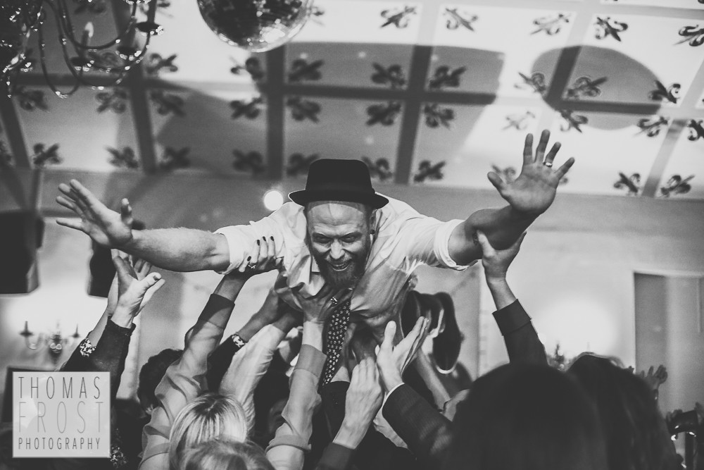 Crowdsurfing groom at Prittlewell Priory Wedding, Southend-on-sea.