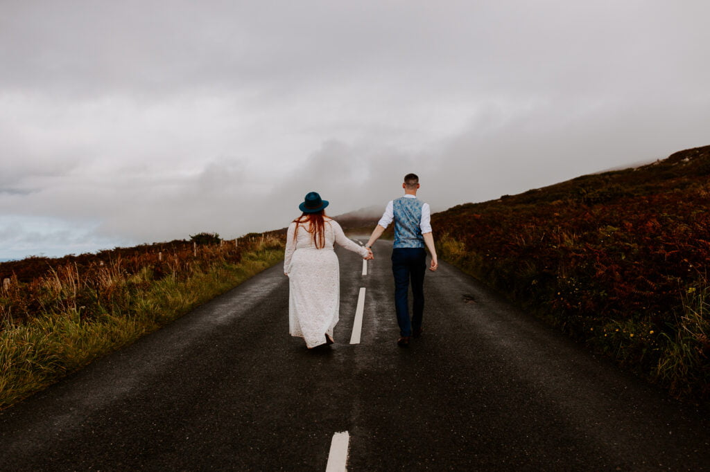 Couple walking down a road eloping