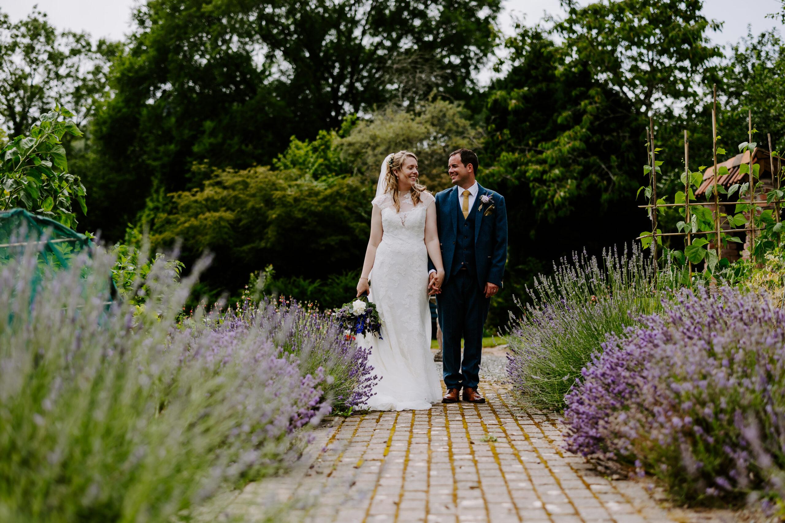 wedding day couple in gardens