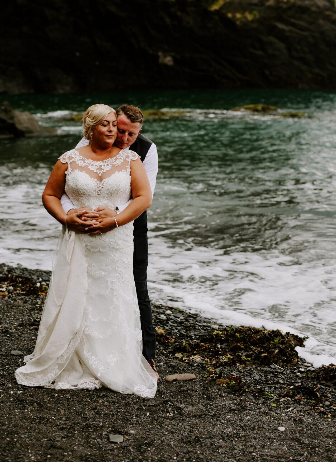 romantic beach image of bride and groom at Devon wedding