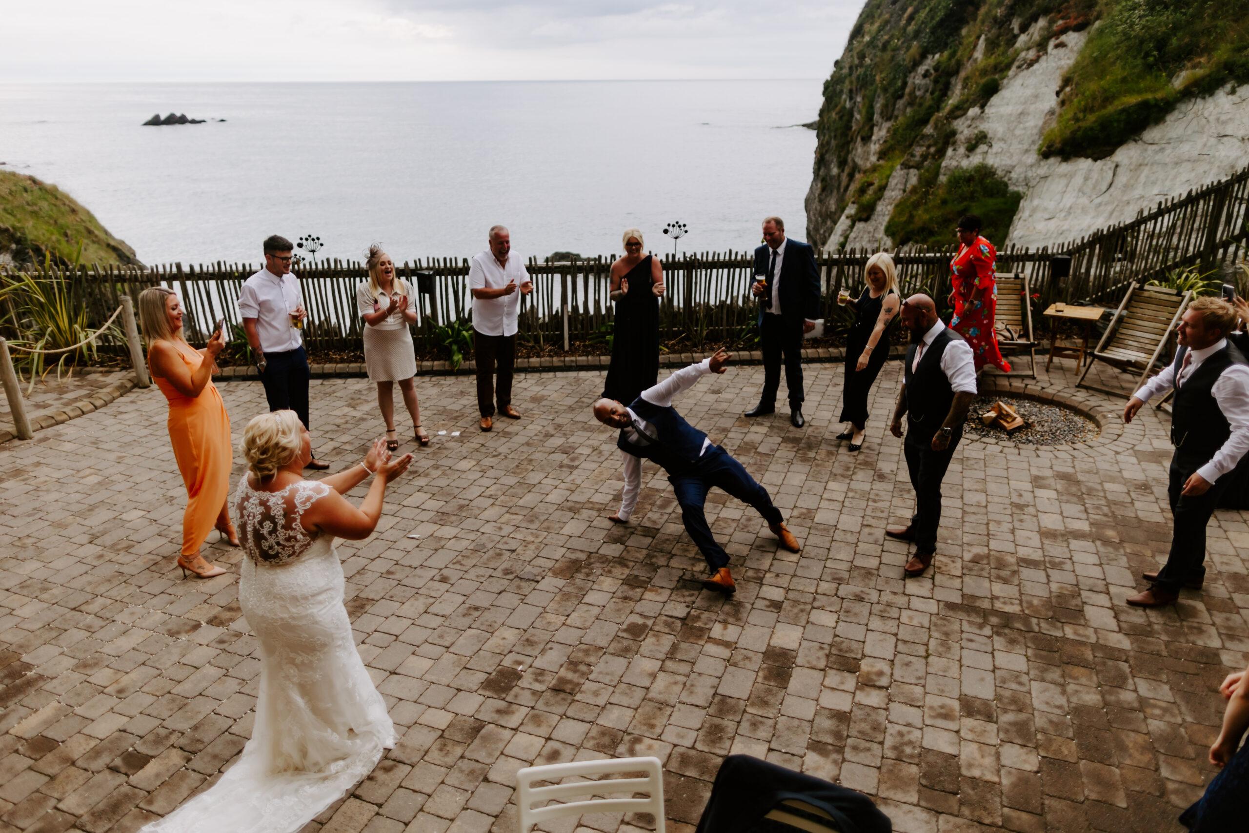 Break dancing at Devon wedding