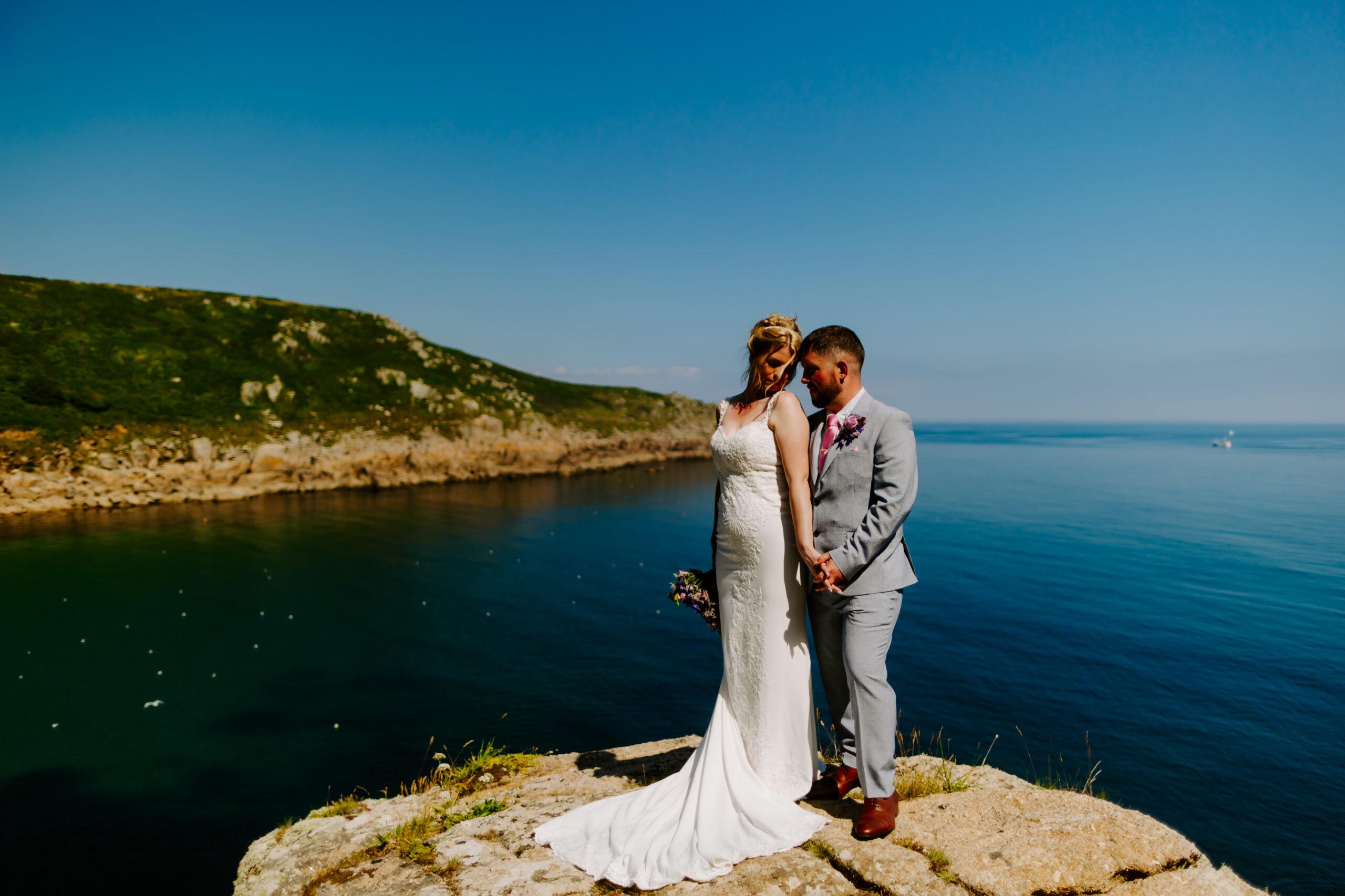 clifftop couple at Cornwall wedding